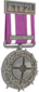 Painted Tournament Medal - ETF2L Highlander 7D4071 Participant.png
